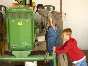 Whether you're a big farm kid or a small farm kid, there's always work to be done on your favorite tractor.