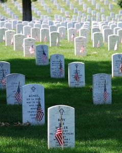 """Graves at Arlington on Memorial Day"" by Remember - Own work. Licensed under Public Domain via Wikimedia Commons - http://commons.wikimedia.org/wiki/File:Graves_at_Arlington_on_Memorial_Day.JPG#/media/File:Graves_at_Arlington_on_Memorial_Day.JPG"